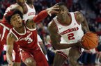 Georgia's Jordan Harris (2) looks to shoot while defended by Arkansas guard Desi Sills (3) during an NCAA college basketball game in Athens, Ga., Saturday, Feb. 29, 2020. (Joshua L. Jones/Athens Banner-Herald via AP)