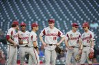 Arkansas teammates (from left to right) Jacob Nesbit, Christian Franklin, Robert Moore, Heston Kjerstad, Braydon Webb and Casey Martin wait for a video review during an NCAA baseball game against Oklahoma on Friday, Feb. 28, 2020, in Houston. (AP Photo/Matt Patterson)