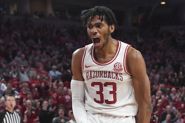 Arkansas' Jimmy Whitt reacts after scoring in the final minutes of a 99-90 victory over LSU on Wednesday, March 4, 2020, in Fayetteville.