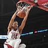 Arkansas forward Ethan Henderson dunks during a game against LSU on Wednesday, March 4, 2020, in Fayetteville.