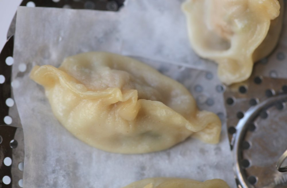 Dumplings can be steamed using a metal vegetable steamer lined with parchment paper. (Arkansas Democrat-Gazette/John Sykes Jr.)
