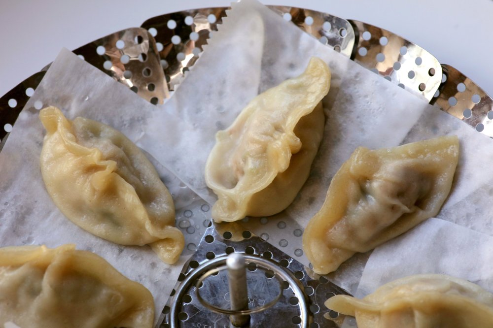 Pork and Chive dumplings made with homemade gyoza wrappers.  (Arkansas Democrat-Gazette/John Sykes Jr.)