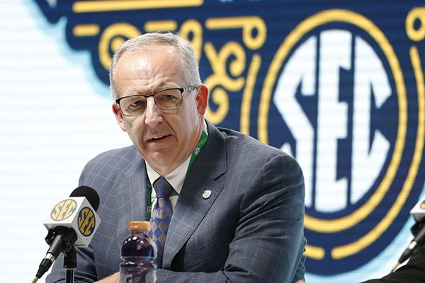 SEC Commissioner Greg Sankey announces Wednesday, March 11, 2020, that fans will not be allowed in the arena to watch NCAA college basketball games in the SEC tournament in Nashville, Tenn., starting Thursday. The Southeastern Conference joined the rest of the Power Five leagues and announced that only family and essential personnel would attend its men's and women's tournament basketball games.  (AP Photo/Mark Humphrey)