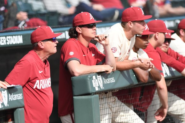 Arkansas' head coach Dave Van Horn (left) watches from the dugout during the Hogs' 10-9 win over Grand Canyon University Wednesday March 11, 2020 at Baum-Walker Stadium in Fayetteville. Van Horn, along with other spring sports coaches, were asked questions on a teleconference this week.