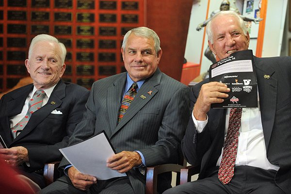 Former Arkansas football coaches Frank Broyles (left), Ken Hatfield (center) and Danny Ford are shown during the unveiling of the Burlsworth Trophy on Monday, Aug. 23, 2010, in Fayetteville.
