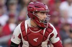 Arkansas catcher Casey Opitz (12) looks to throw after picking up a loose ball during an NCAA baseball game against Oklahoma on Friday, Feb. 28, 2020 in Houston. (AP Photo/Matt Patterson)