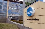 This March 12, 2020, file photo, shows the national office of the NCAA in Indianapolis. (AP Photo/Michael Conroy)