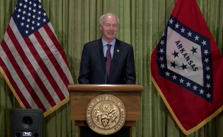 Arkansas Gov. Asa Hutchinson speaks to reporters Monday at the state Capitol in Little Rock in this screen grab of video provided by the governor's office.