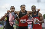 Former Arkansas sprinter Wallace Spearmon Jr. (center) of Fayetteville celebrates in 2012 with Maurice Mitchell (left) and Isiah Young after making the U.S. Olympic track and fi eld team in the 200 meters. Spearmon was taking aim at his third Olympics appearance before the Tokyo Games were postponed until 2021 by the coronavirus pandemic. (AP fi le photo)