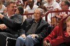 NWA Democrat-Gazette/ANDY SHUPE Former Arkansas and Kentucky coach Eddie Sutton (center) laughs Thursday, Jan. 21, 2016, with former Razorbacks Joe Kleine (left) and Darrell Walker during the first half of play in Bud Walton Arena in Fayetteville. Visit nwadg.com/photos to see more photographs from the game.