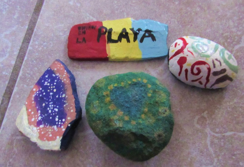 Rock on by painting smooth-sided, clean rocks with lively colors or messages; a project kids can make for entertainment during the covid-19 pandemic. (Special to the Democrat-Gazette/Kimberly Dishongh)