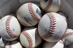 This picture taken with a fisheye lens shows a bucket of balls at the Milwaukee Brewers spring training baseball workout Tuesday, Feb. 19, 2013, in Phoenix. (AP Photo/Morry Gash)