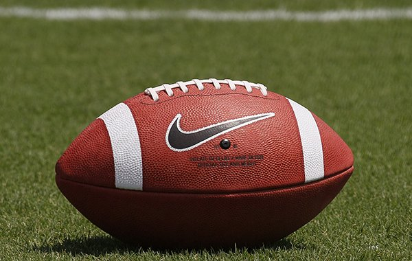 An NCAA football is shown in this file photo. (AP Photo/Gerry Broome)