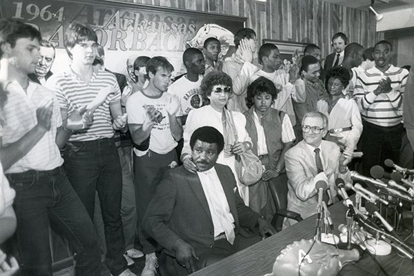 Nolan Richardson (seated at left) and Frank Broyles (seated right) are shown during Richardson's introductory news conference as Arkansas' basketball coach on Tuesday, April 9, 1985, in Fayetteville.