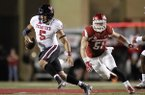 Arkansas linebacker Brooks Ellis (51) chases Texas Tech quarterback Patrick Mahomes II during the second half of an NCAA college football game, Saturday, Sept. 19, 2015, in Fayetteville, Ark. Texas Tech beat Arkansas 35-24. (AP Photo/Samantha Baker)
