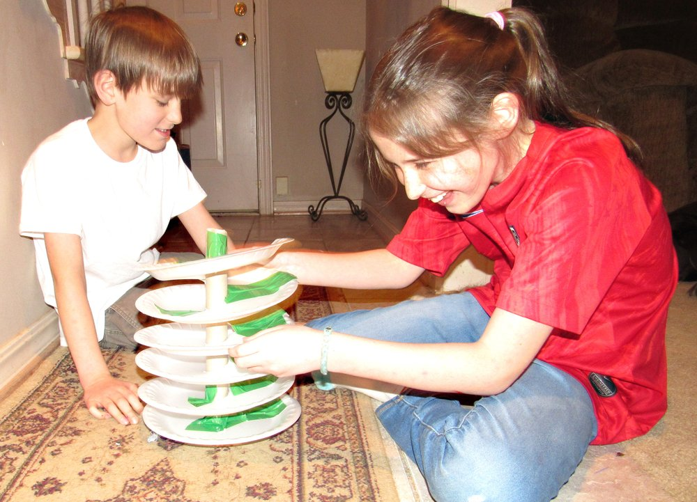 Charlie, 8, and Julianna Dishongh, 10, set up their marble race track in this craft activity for kids stuck at home during the covid-19 crisis. (Special to the Democrat-Gazette/Kimberly Dishongh)