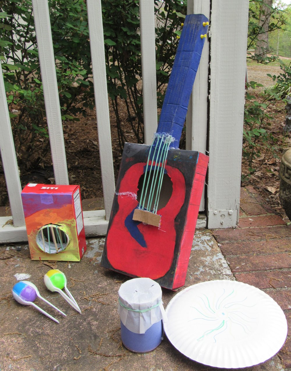 Musical instruments made from household items include (clockwise from far left) Easter egg maracas, pasta box banjo, cereal box guitar, pie pan tambourine and a drum made from a can. (Special to the Democrat-Gazette/Kimberly Dishongh)