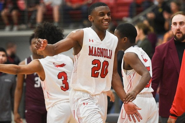 Magnolia guard Derrian Ford (20) reacts, Friday, March 6, 2020 during a basketball game at Cardinal Arena at Farmington High School in Farmington. Ford also lead the team on Saturday with 36 points in a 2 OT win over Brookland to advance to the Class 4A State Boys final for a second straight year.