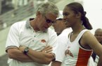 Arkansas coach Lance Harter talks with DeeDee Brown during the SEC Outdoor Track and Field Championships on Friday, May 14, 1999, in Athens, Ga.
