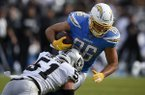 Oakland Raiders linebacker Will Compton, front, tackles Los Angeles Chargers tight end Hunter Henry during the first half of an NFL football game in Carson, Calif., Sunday, Dec. 22, 2019. (AP Photo/Kelvin Kuo)