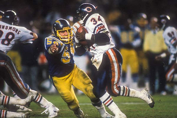 San Diego Chargers linebacker Billy Ray Smith Jr. attempts to tackle Chicago Bears running back Walter Payton (34) during a game Monday, Dec. 3, 1984, in San Diego.