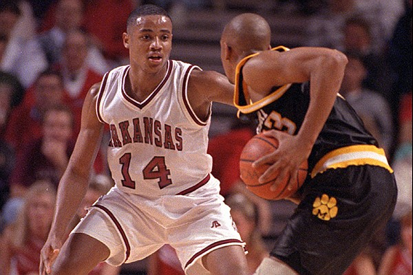 Arkansas guard Corey Beck (14) defends an unidentified Missouri player during a game Thursday, Dec. 2, 1993, in Fayetteville. The Razorbacks defeated the Tigers 120-68 in the dedication game at Bud Walton Arena.