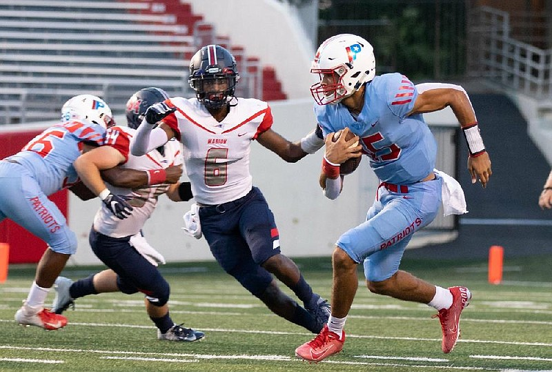 Little Rock Parkview quarterback Landon Rogers (right) rushed 93 times for 584 yards and 10 touchdowns last season as a junior for the Patriots. (Arkansas Democrat-Gazette/Justin Cunningham)