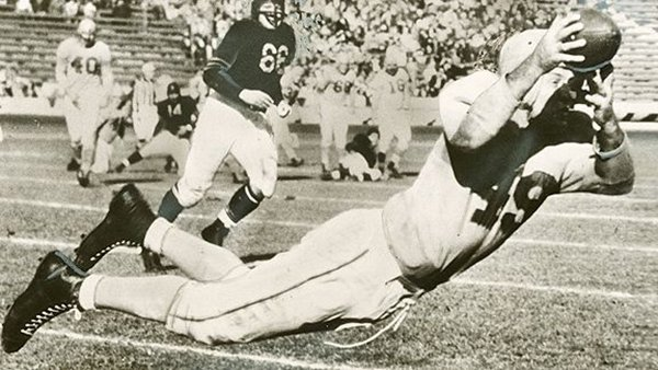 Jim Benton, shown attempting to make a catch in this undated photo, was an All-American as a senior at Arkansas in 1937 before a long NFL career in which he won two league championships.