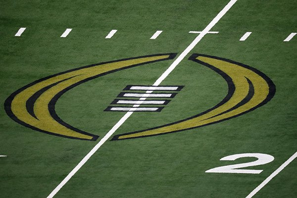 The College Football Championship Playoff logo is shown on the field at AT&T Stadium during the NCAA Cotton Bowl semifinal playoff football game between Clemson and Notre Dame on Saturday, Dec. 29, 2018, in Arlington, Texas. (AP Photo/Roger Steinman)