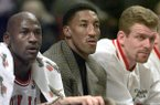 Chicago Bulls' injured player Scottie Pippen sits on the bench between teammates Michael Jordan, left and Joe Kleine in the first period against the Milwaukee Bucks, Friday Dec. 5, 1997, in Chicago. (AP Photo/Michael S. Green)