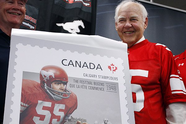 Former Calgary Stampeders linebacker Wayne Harris is shown in 2012 with a stamp that commemorated his playing days in the Canadian Football League.