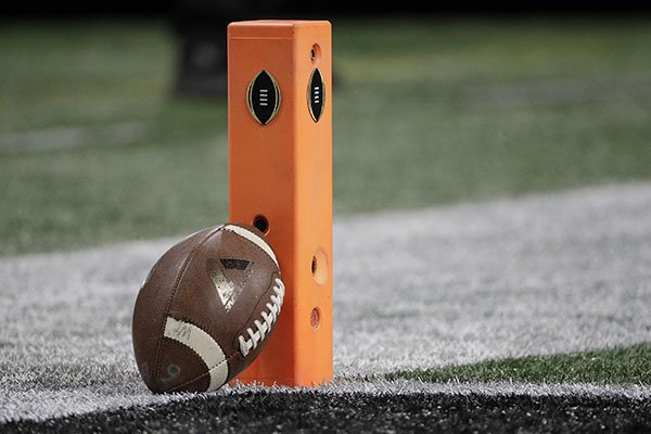 A football rests on a pylon before the NCAA college football playoff championship game between Georgia and Alabama, Monday, Jan. 8, 2018, in Atlanta. (AP Photo/David J. Phillip)