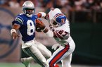 Denver Broncos safety Steve Atwater (27) hits Seattle Seahawks receiver Louis Clark (84) during the fourth quarter of a game Sunday, Oct. 23, 1989, in Seattle. (AP Photo/Barry Sweet)