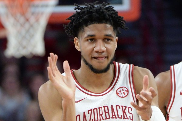 Arkansas guard Isaiah Joe celebrates a 3-point basket Friday, Feb. 21, 2020, during the first half of play against Missouri in Bud Walton Arena in Fayetteville.