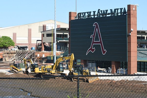 Construction crews work at the future site of the J.B. Hunt Family Baseball Performance Center on Wednesday, April 29, 2020, in Fayetteville.