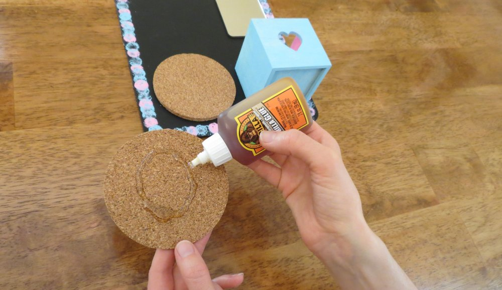 6. Glue the cork discs, one on top of the other, on the bottom left of the chalkboard. Let all glued items dry flat for two hours. (Photo for The Washington Post by Kris Coronado)