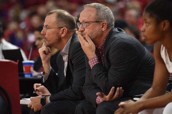 Arkansas women's basketball coach Mike Neighbors and associate head coach Todd Schaefer are pictured on November 8, 2019 during the Razorbacks' 82-52 victory over New Orleans.
