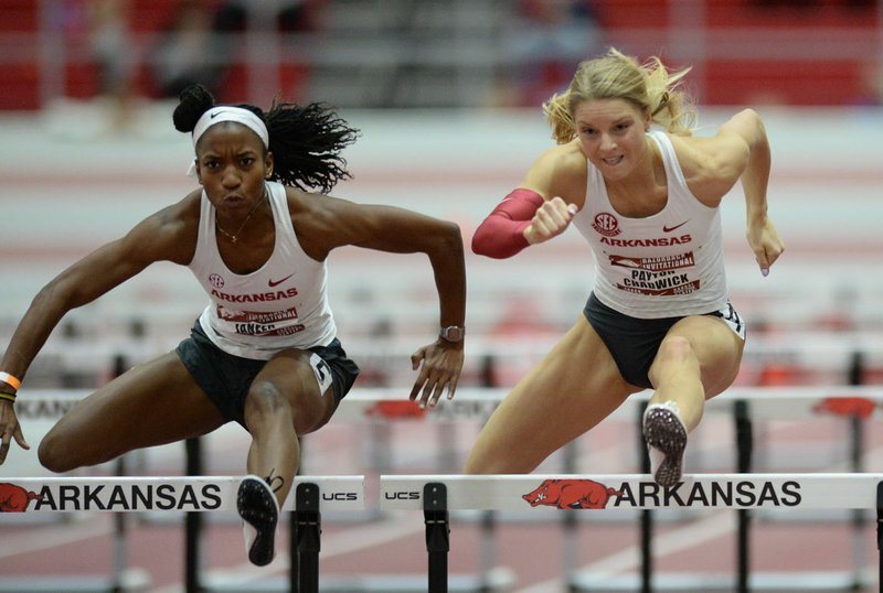 Former Arkansas standout Payton Chadwick (right), whose outdoor season ended two weeks before it even started because of the coronavirus pandemic, spends her days training in Paris, Texas, home of her husband Connor.  (NWA Democrat-Gazette/Andy Shupe)