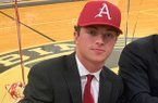 Zac White of Joe T. Robinson signs a letter to play baseball for Arkansas during a ceremony in Little Rock.