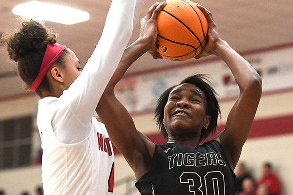 Fort Smith Northside's Jersey Wolfenbarger (left) defends Bentonville's Maryam Dauda during a game Thursday, Dec. 19, 2019, in Fort Smith. Northside won 67-33 in a rematch of the 2019 Class 6A state championship game.