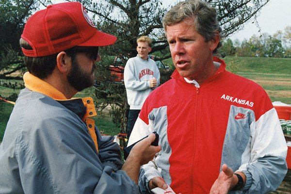 New Arkansas women's track coach Lance Harter speaks to a reporter in 1990.