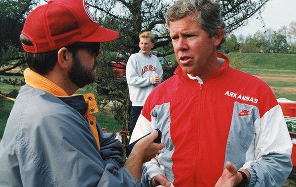 New Arkansas women's track coach Lance Harter speaks to a reporter in 1990.