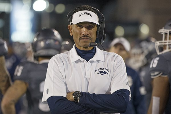 Nevada head coach Jay Norvell works the in second half of an NCAA college football game against New Mexico in Reno, Nev., Saturday, Nov. 2, 2019. (AP Photo/Tom R. Smedes)