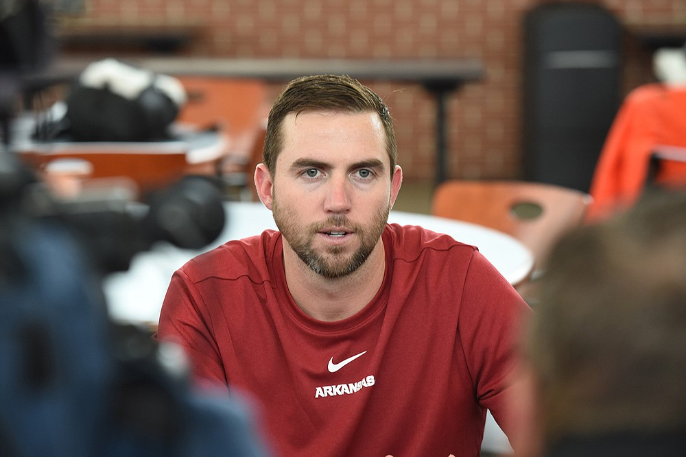 Arkansas offensive coordinator Kendal Briles speaks with members of the media Feb. 6 inside the Fred W. Smith Football Center on the campus in Fayetteville. (NWA Democrat-Gazette/David Gottschalk)