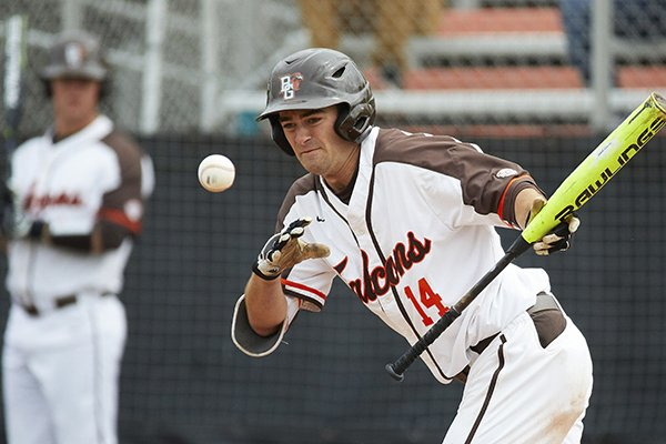In this May 10, 2019, file photo, Bowling Green's Neil Lambert bats during the team's NCAA college baseball game against Kent Sate in Bowling Green, Ohio. Bowling Green recently announced that it is dropping baseball. Colleges mulling whether to cut sports amid the coronavirus pandemic must ensure they remain compliant with the federal civil-rights law known as Title IX, which requires the equitable treatment of remaining men's and women's programs. (AP Photo/Rick Osentoski)