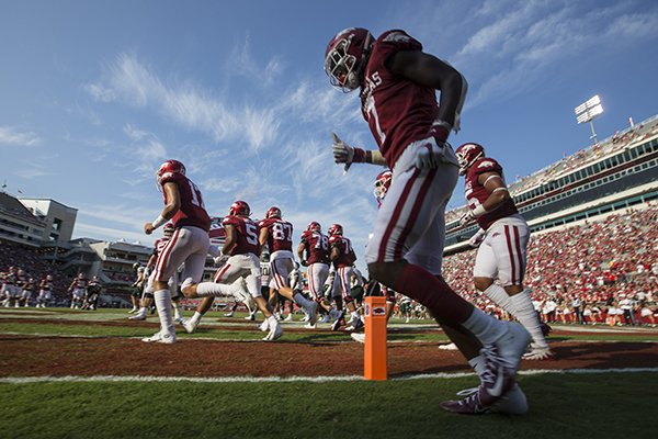 Arkansas players take the field during a game against Colorado State on Saturday, Sept. 14, 2019, in Fayetteville.