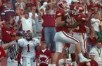 Arkansas tight end Ben Cleveland (with ball) celebrates with teammate Felix Jones while Alabama defensive back Ramzee Robinson (1) looks on after Cleveland caught the game-tying touchdown in the second overtime of a game Saturday, Sept. 23, 2006, in Fayetteville.