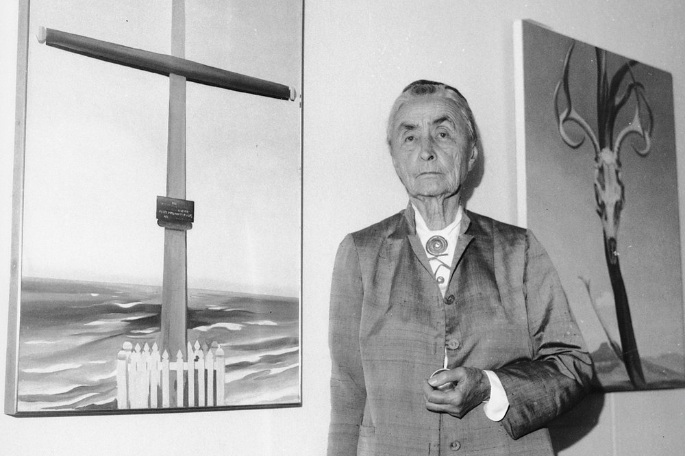 Georgia O'Keeffe was photographed in 1970 at an exhibition of her work at the Whitney Museum of American Art in New York. O'Keeffe's home and studio is one of the entries in a new book from the National Trust for Historic Preservation, Guide to Historic Artists' Homes & Studios.  (AP)