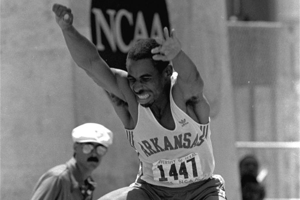 Mike Conley of the University of Arkansas goes through the air in the mens triple jump finals at the NCAA Outdoor Track and Field Championships at Austin, Texas Saturday, June 1, 1985. Conley made a jump of 57 feet 6 1/2 inches to win the event. It was the number 3 jump of all-time in the United States and a personal best for Conley. (AP Photo/Bill Belknap)