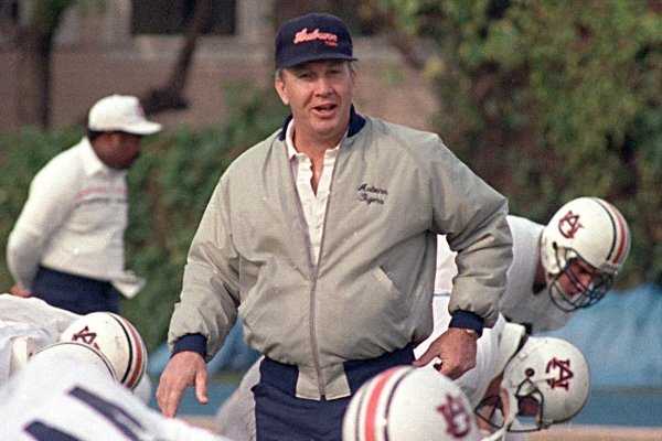 Auburn coach Pat Dye walks through his players as they begin workouts in preparation for the Sugar Bowl in New Orleans, in this Dec. 27, 1988 file photo. (AP Photo/Bill Haber, File)